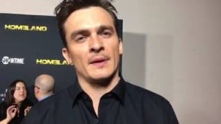 "Rupert Friend chats ""Homeland"" on red carpet at Emmy FYC event"