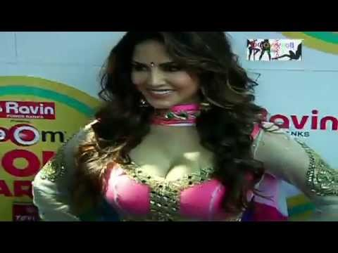 Sunny Leone Exposing Cleavage in Tight White Dress thumbnail