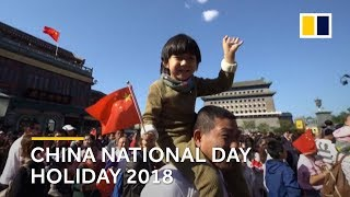 China celebrates National Day 'Golden Week' holiday with colour and crowds