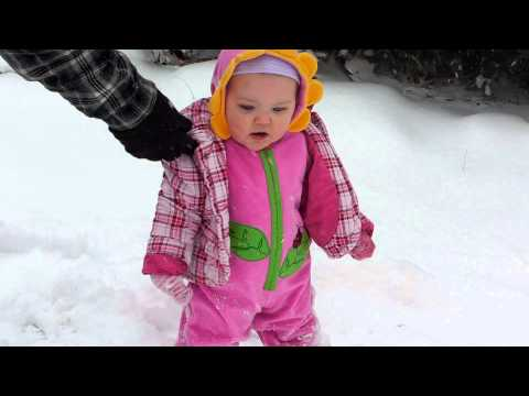 baby face plants in the snow
