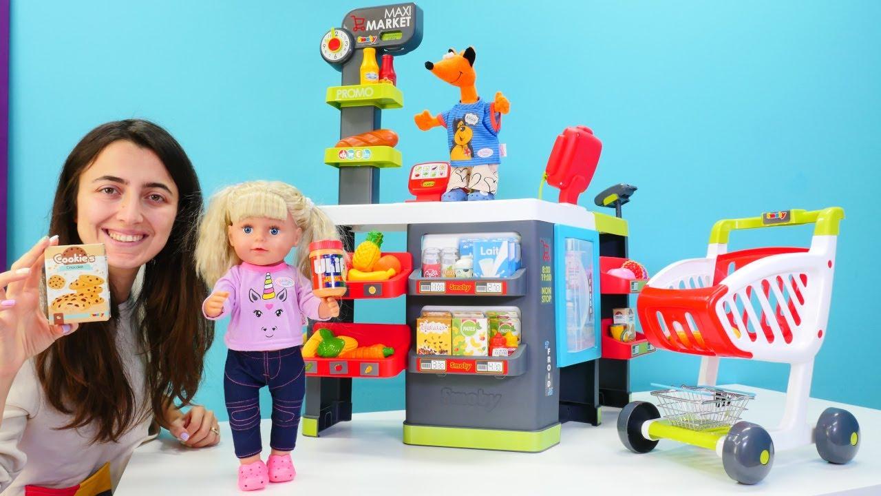Baby born oyuncak bebek Mira ve Sevcan market alışverişine gidiyorlar. Kız oyunları