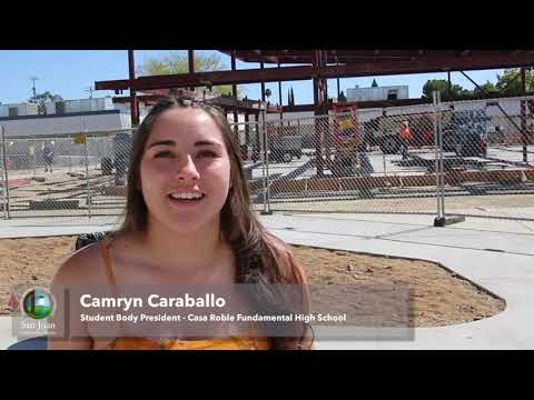 Casa Roble Fundamental High School students sign steel beam for new student union