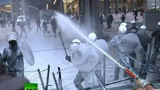 Dairy of Mad Men: Angry farmers spray milk on riot police in Brussels