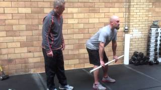 How to Stretch Hamstrings With Stick - Beginner Stretch