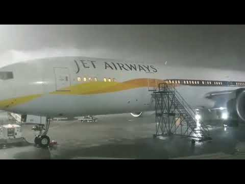 jet airways staff doing there duty in heavy rain at mumbai airport