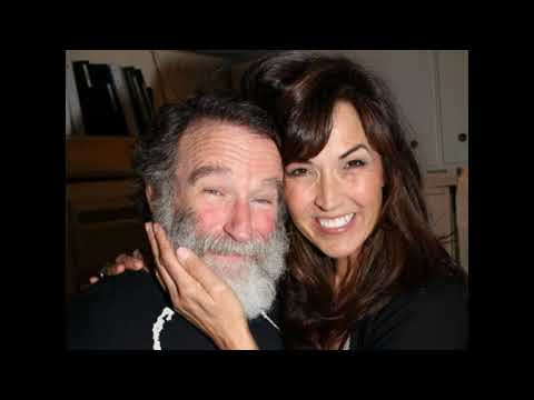 Comedian Robin Williams and his wife Susan Schneider and a daughter