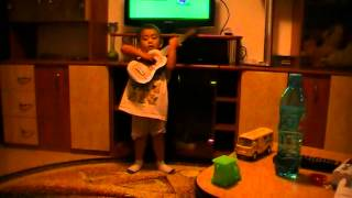 romanian boy  sing bahay kubo with guitar