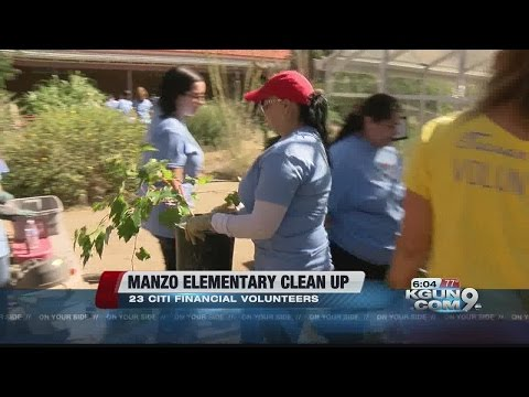 Volunteers help clean up Manzo Elementary School
