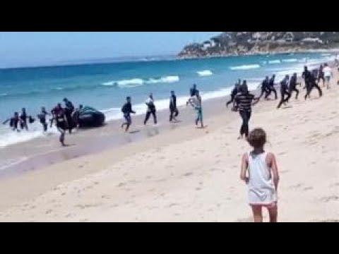 Migrants Storm Spanish Beach