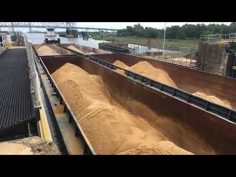 Watch barges moving through Industrial Canal lock in New Orleans.