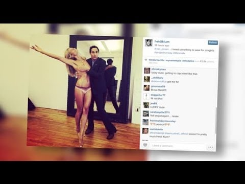 Heidi Klum posiert oben ohne mit dem Designer Zac Posen