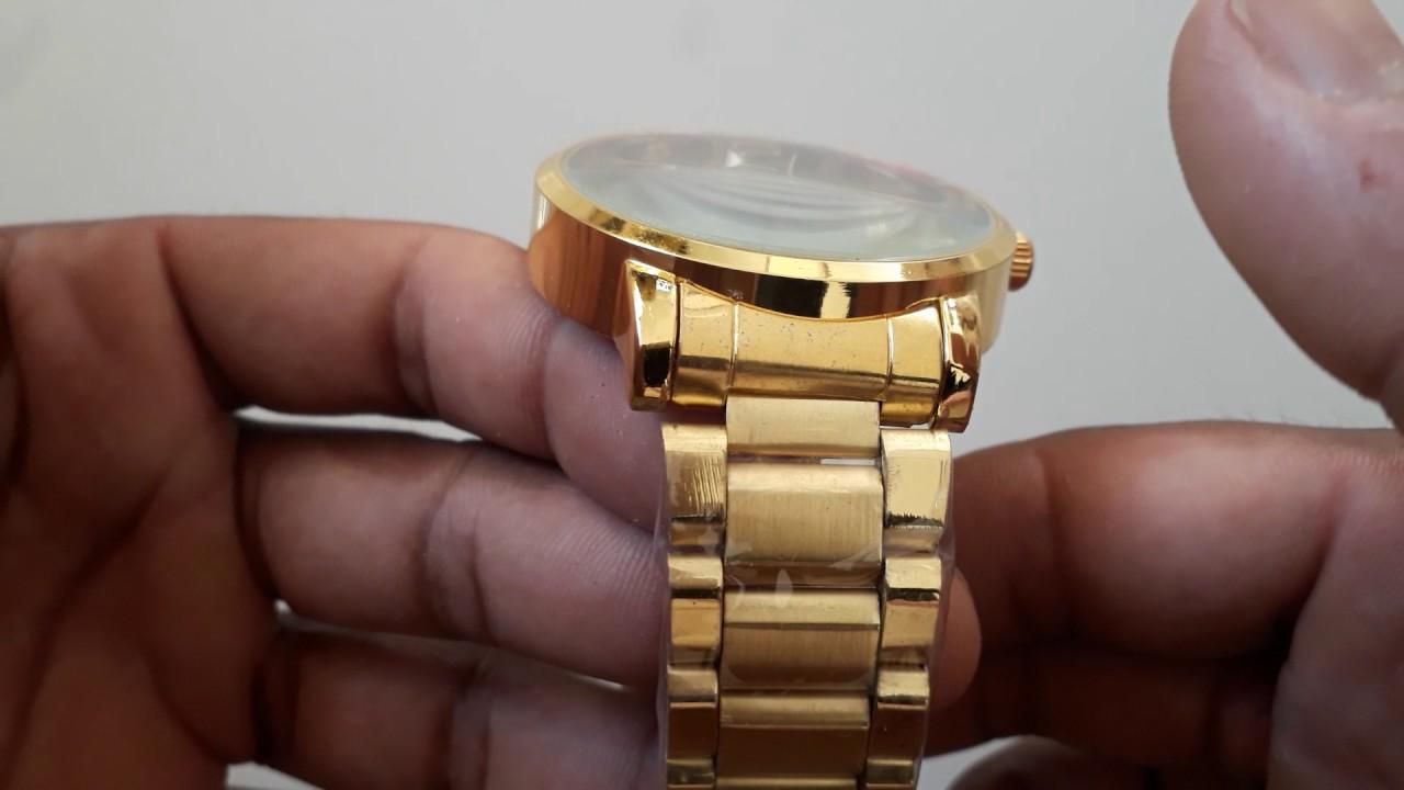 22d91454b4438 Relógio Quiksilver dourado fundo vermelho - YouTube