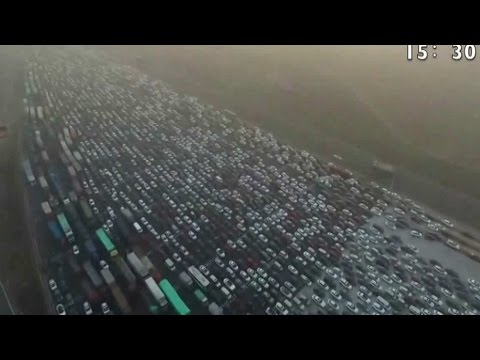 Watch the incredible footage of a 50-lane holiday traffic jam in China