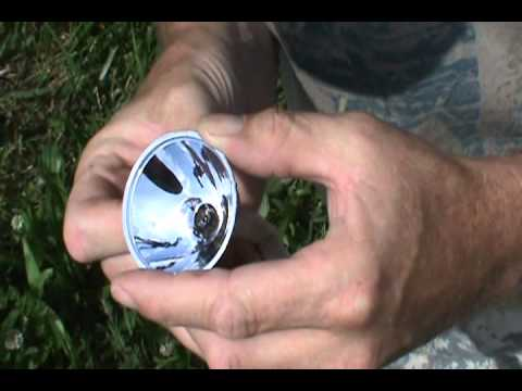 The Ky Woodsman- Making Fire with a small Flashlight Reflector
