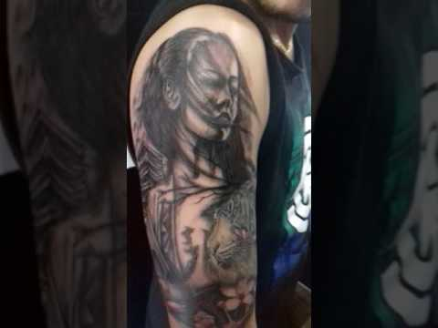 Tattoo de gueixa e tigre