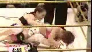 Japan's Megumi Fujii defeats Australian Serin Murray via a figure four toe hold. This Smack Girl fight, at Fujii's urging, was fought under full MMA rules rather ...