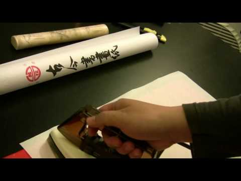 How to Reduce Wrinkles of Xuan Paper for Chinese Calligraphy Writing