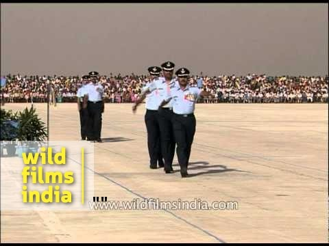 Indian Air Force officers march off wearing medals of honour