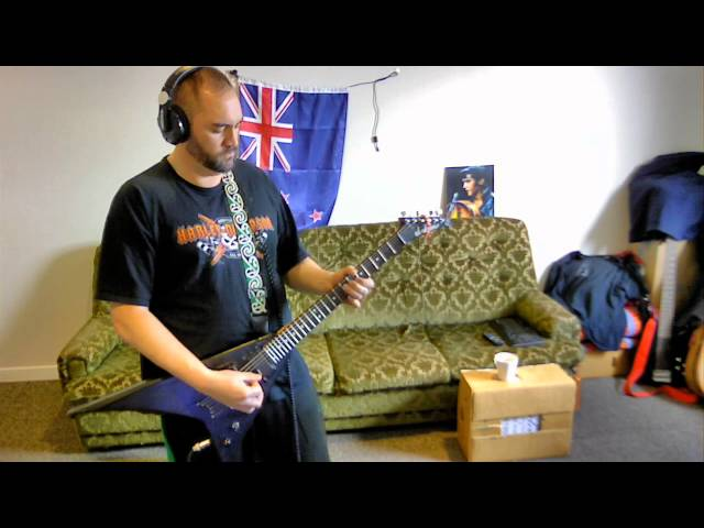 Dave playing heavy guitar riffs
