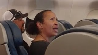 Angry woman gets escorted off plane by police