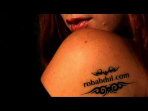Babe tattoos Rob Abdul dot com on her body