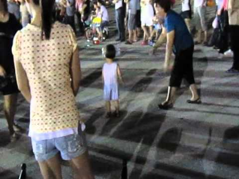 Little Chinese Girl Dancing in ShenZhen Square