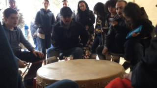 Little River Band of Ottawa Indians tribe members perform on community drum