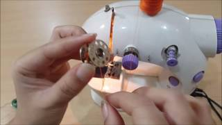 Cara menggulung benang ke dalam bobin menggunakan mesin jahit mini portable