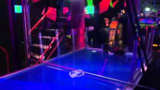 Robot playing air hockey