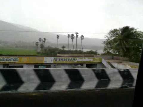 paddy fields, hills, lake and rain