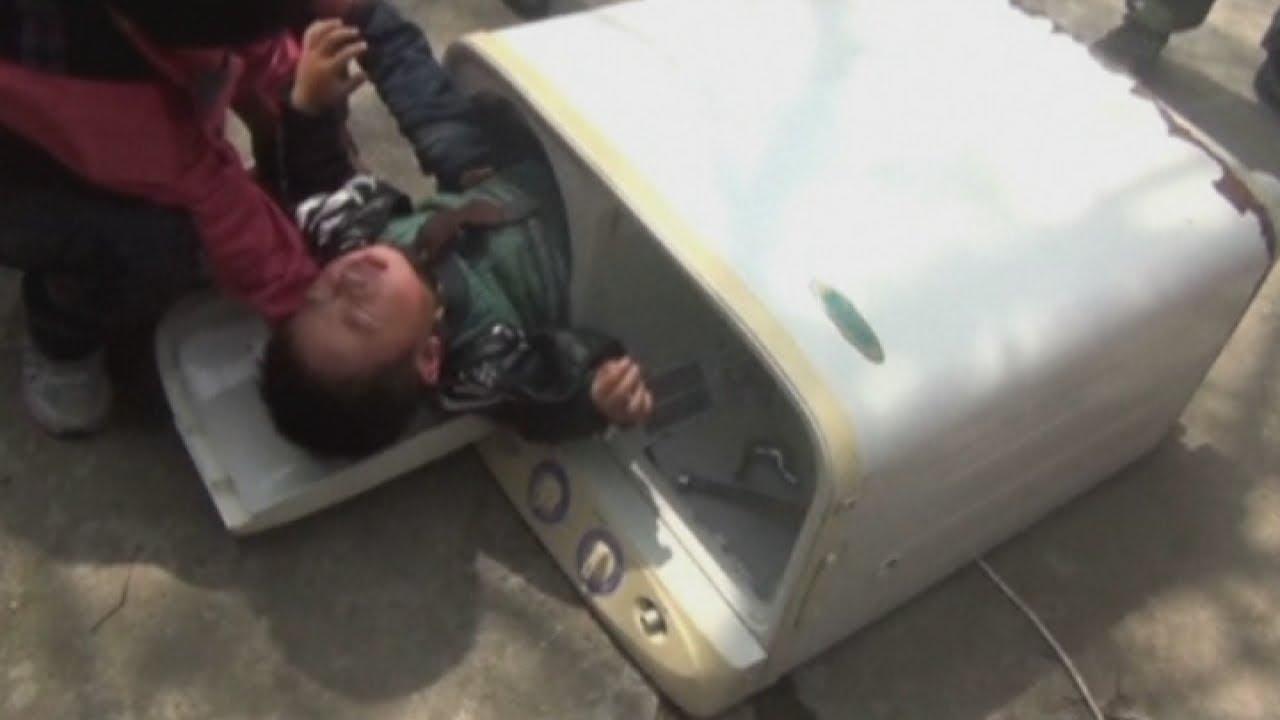 child in washer machine