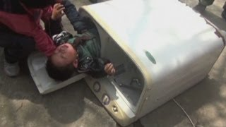 Two-year-old boy rescued from washing machine