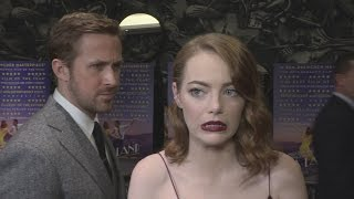La La Land gala: Ryan Gosling creeps up on Emma Stone!