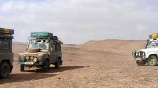 Hotchkiss jeep in caravan at edge of sahara