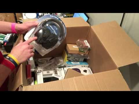 Liquidation auction unboxing electronics for resell on eBay