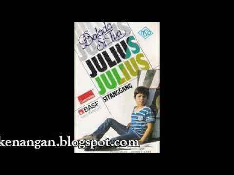 Julius Sitanggang  -  Antara Kota dan Desa