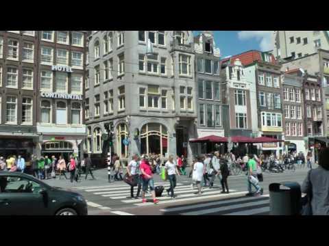 Damrak Avenue in Amsterdam, the Netherlands, between Prins Hendrikkade and Dam Square