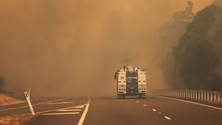Fires billowed so much smoke Taree 'couldn't open the doors'
