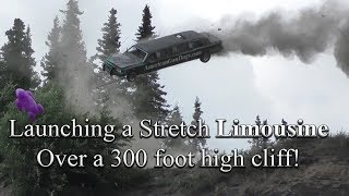 Launching a stretch limo over a 300 foot high cliff! In car video footage!!