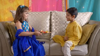 Raksha Bandhan - Excited brother watches his sister performing aarti / prayer