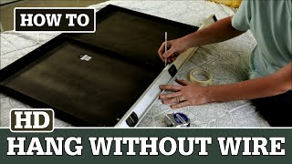 how to hang a picture with no wire and two hooks