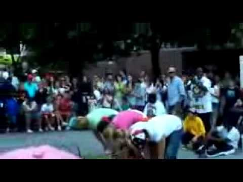 A Street Performer Jumps Assorted White People + Asian Father