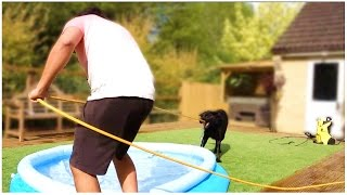 PUPPY FIGHTS WITH HOSE...!!!