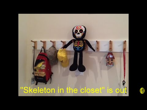 Homemade coat rack for foyer wall (watch out for the skeleton)