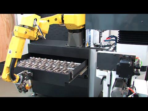Fa. Henninger - Zentrumschleifmaschinen mit Handlingsystem