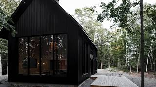 A Black Metal Cottage In Quebec With A Stunning Interior