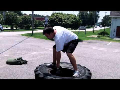 Heavy tire, sandbag and kettlebell workout