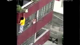 Boy hangs off 4th-story balcony in Guangdong, China