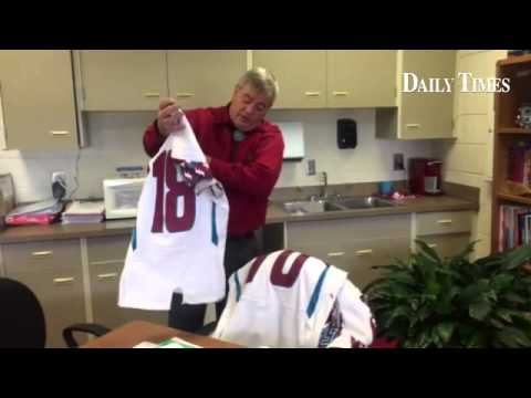 Shiprock High School principal Rick Edwards shows damaged football jerseys kept in his office, Wedne