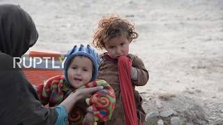 Afghanistan: 'We are all war victims' - displaced families living in makeshift camp